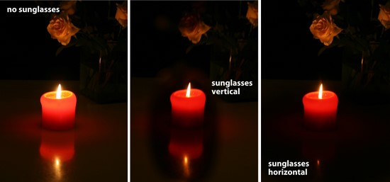 reflection of a candle seen through sunglasses